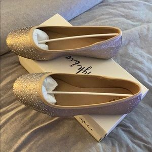 Gold colored flats size 9w.. worn once only.